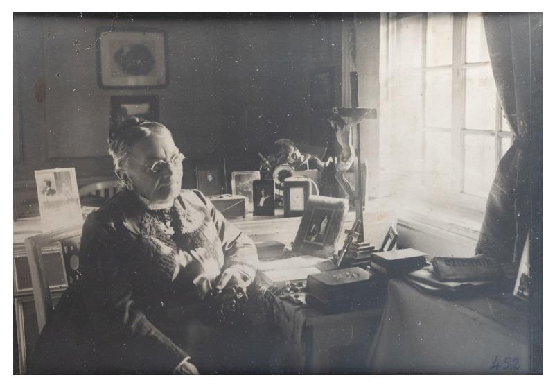 Sofija Tiškevičienė (1837-1919), seen sitting at the window in her room, c. 1919